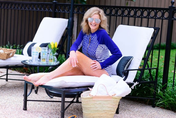 Tanya Foster in Cabana Life swimsuit on a lounge chair
