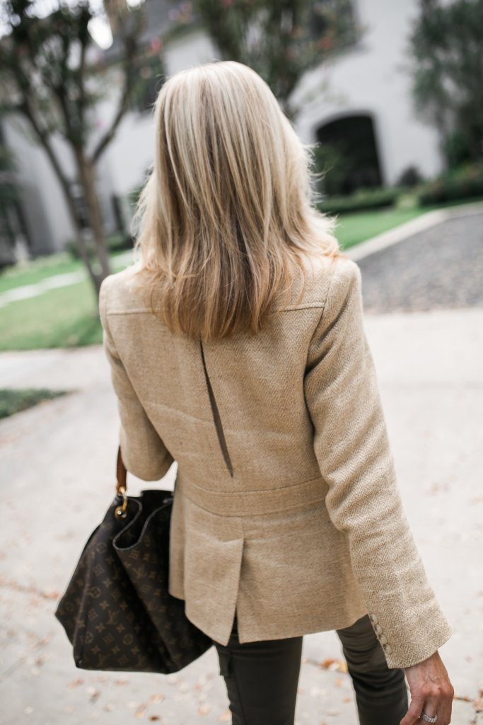 A Ralph Lauren blazer, green Joie pants, and gold Aquazzura flats