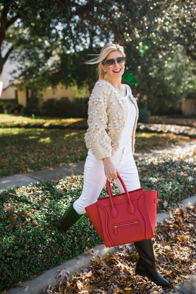 Chicwish knitted sweater over white shirt and white denim with a red Celine bag and black riding boots