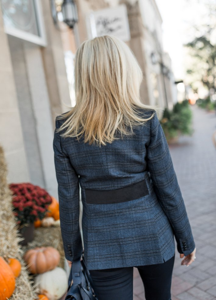 Dress up your premium denim look with a Veronica Beard blazer, black cashmere turtleneck and black booties