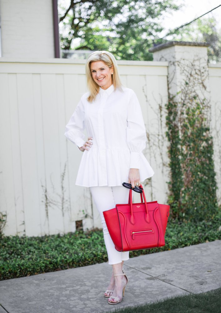 White Veronica Beard jeans, white H&M top, red Celine bag and heels