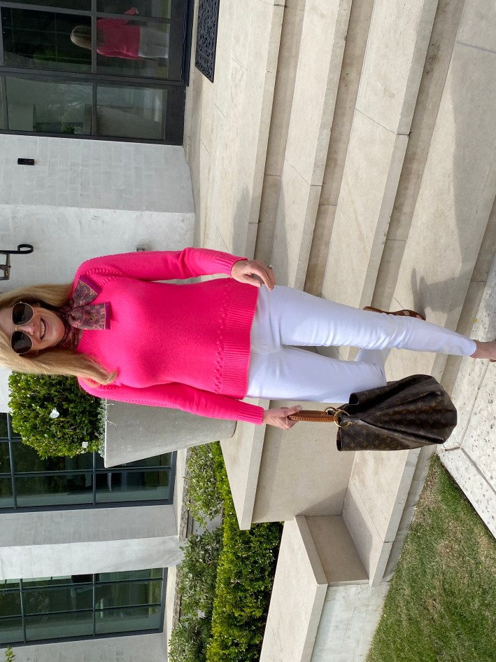 Tanya Foster in sail to sable pink sweater white jeans hermes sandals and louis vuitton bag