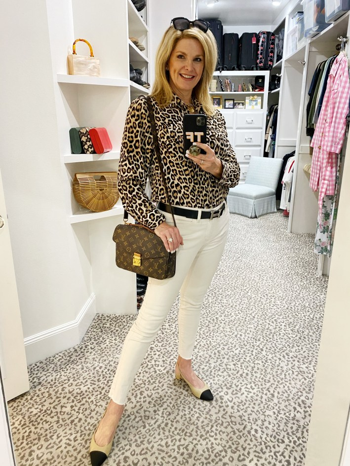 Tanya Foster in animal print Talbots blouse louis vuitton crossbody bag white jeans hermes belt and nude and black shopbop flat shoes