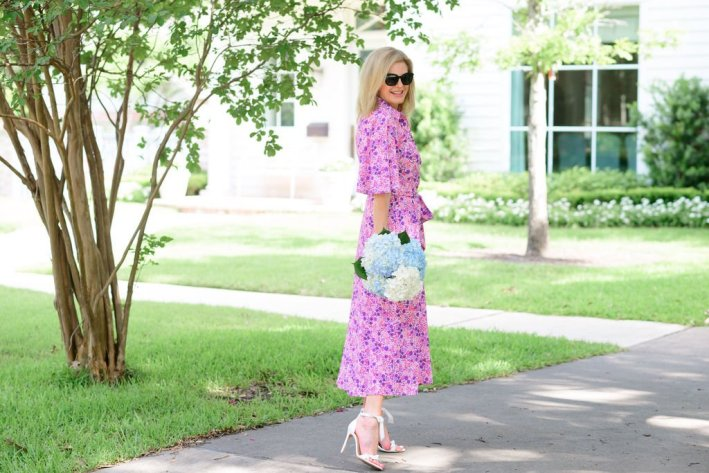 Tanya Foster in Tuckernuck pink floral betty dress with Alexandre Birman Clarita Sandals and tuckernuck straw clutch