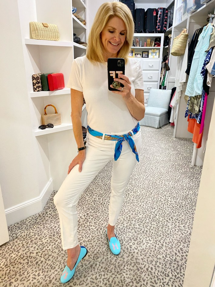 Tanya Foster in white jeans white top hermes scarf and blue shoes