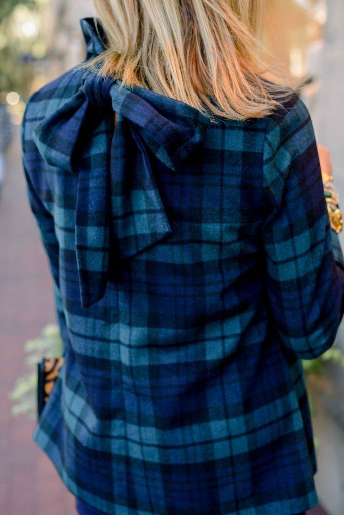 the back of Tuckernuck tartan plaid blouse with a bow