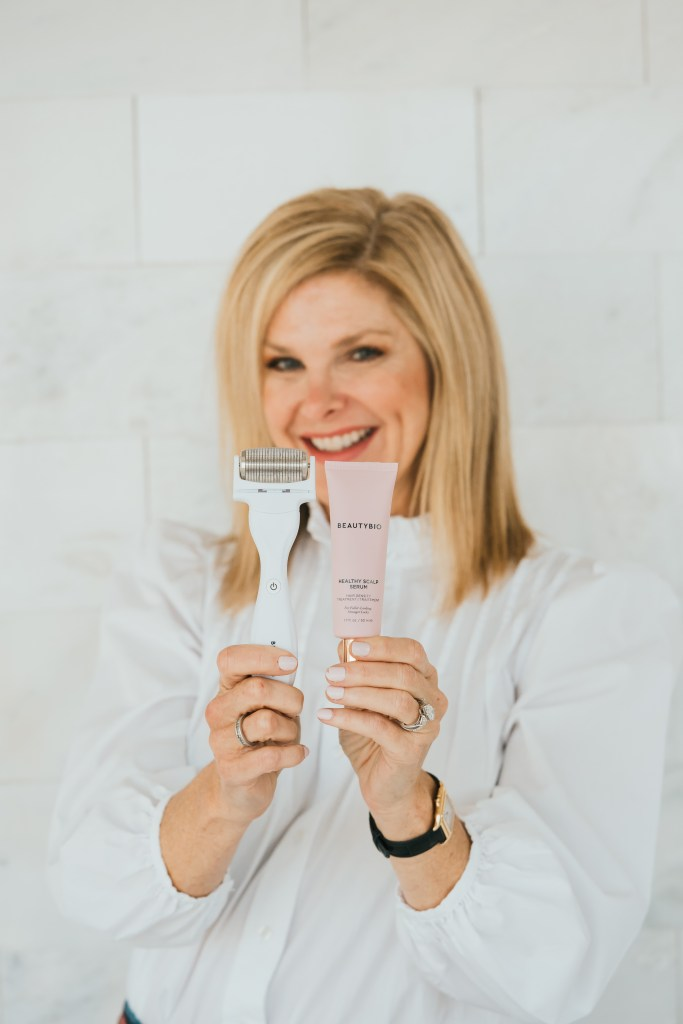 Tanya foster holding beautybio glopro scalp attachment and healthy scalp serum