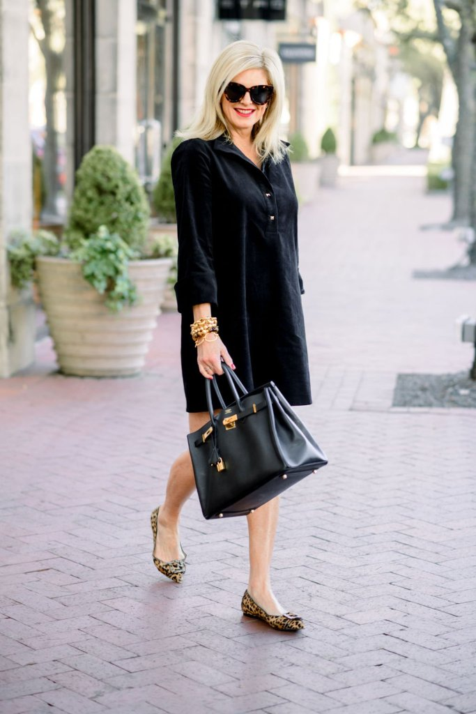 Tanya foster wearing tuckernuck black corduroy dress and sam edelman animal print flats