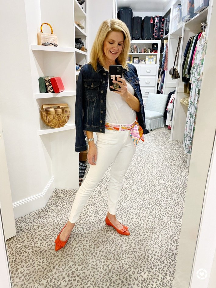 Tanya Foster in orange flats white jeans hermes scarf jean jacket and white shirt