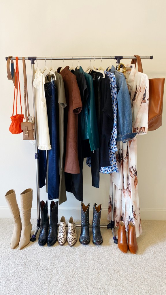 clothing rack of fall hues clothes shoes bags and accessories