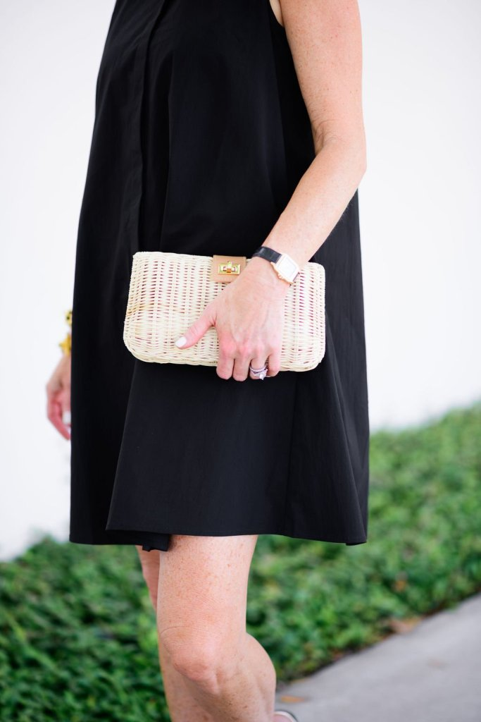 Tuckernuck clutch and black dress for summer