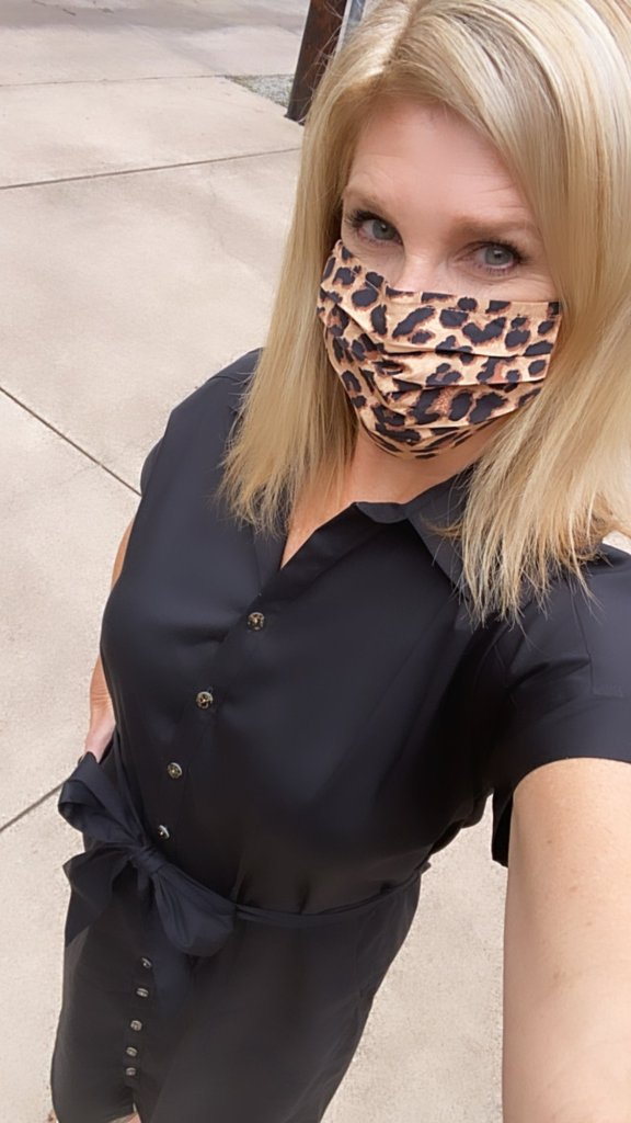 TAnya Foster in francesca's leopard print face mask in chico's black utility dress