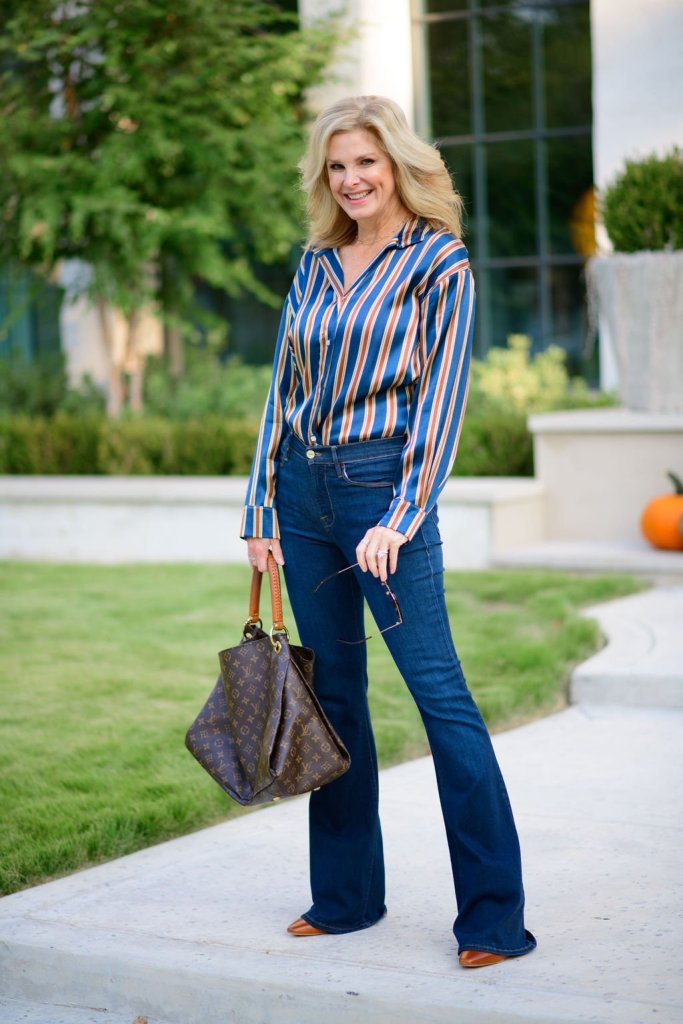 Tanya Foster wearing JAG jewelry and goods George long sleeve blouse in rust and gold stripe