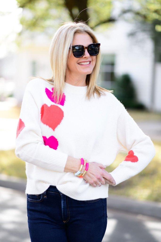 tanya foster wearing loft heart sweater with allie+bess bracelet stack