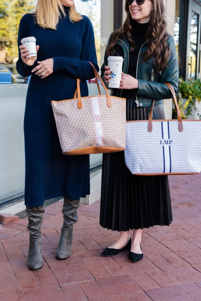 two women holding barrington tote bags and coffee for national coffee day
