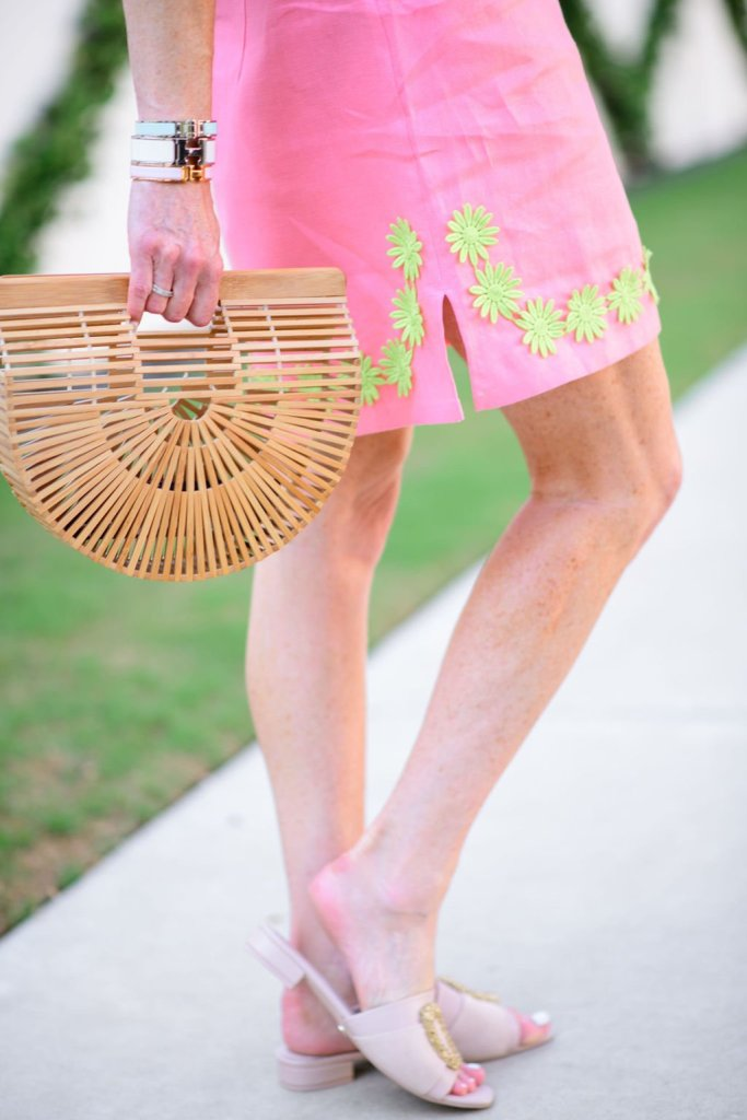Tanya Foster in sail to sable pink embroidered dress and arc bag