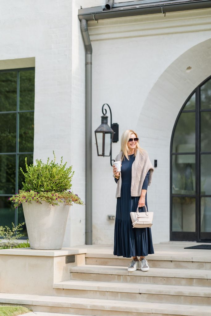 Tanya Foster wearing Saint + Sofia dress and sweater with La Champ bag with p448 sneakers