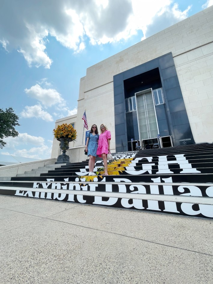 Tanya Foster and assistant standing on the steps of the van gogh exhibit dallas