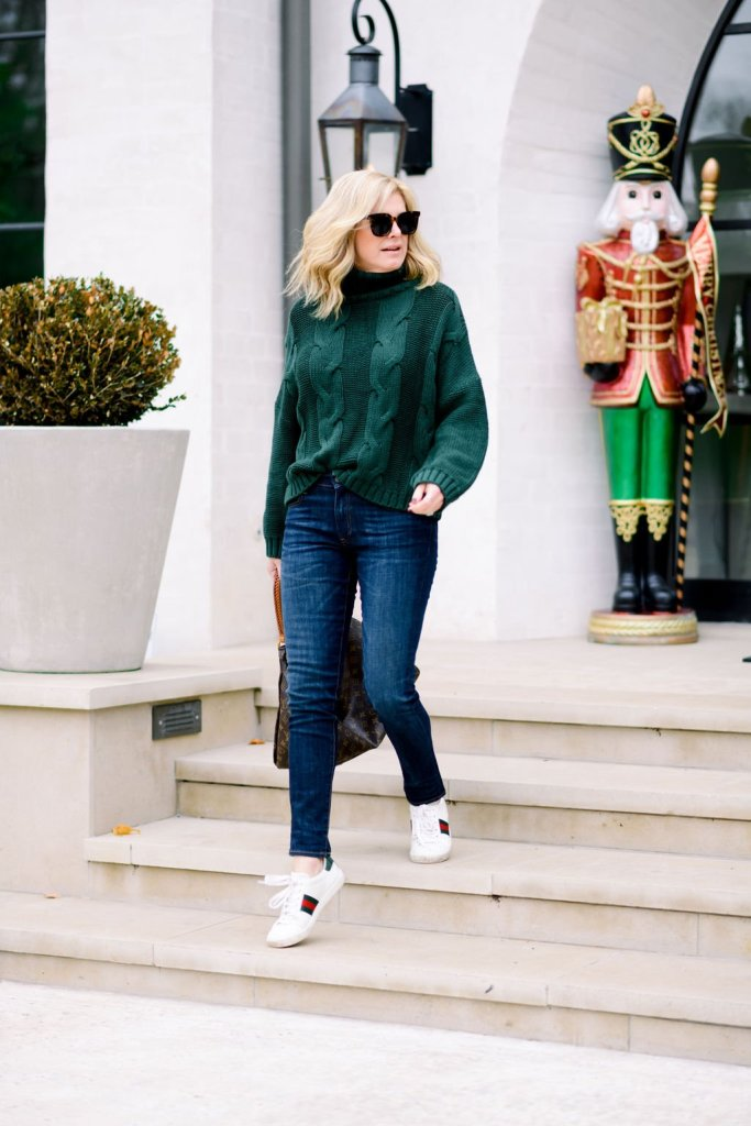 Tanya Foster in amazon cable knit green sweater denim gucci sneakers and louis vuitton purse for a casual holiday style