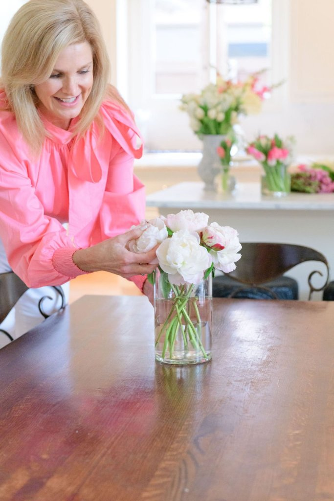 Tanya Foster placing vases down from the flower box arrangement