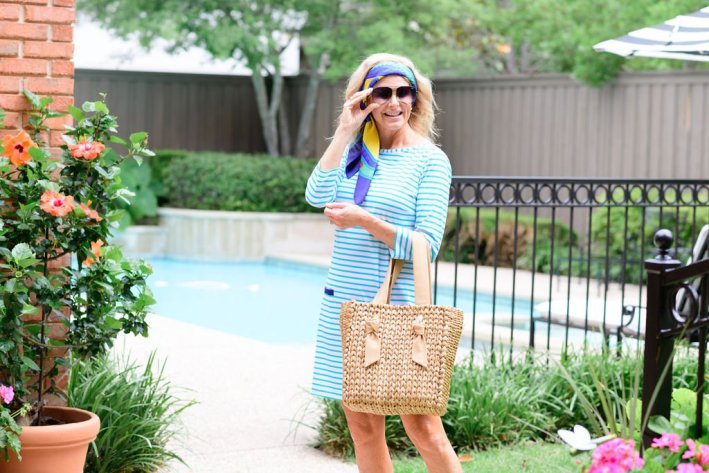 tanya foster in cabana life dress coach shoes and wicker tote bag with hermes scarf as a head band with tom ford sunglasses