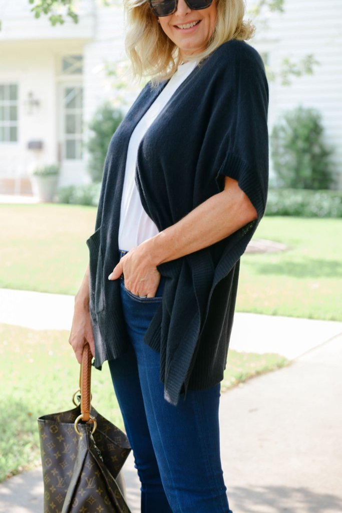 Tanya foster in cashmere sweater white tee denim and louis vuitton bag