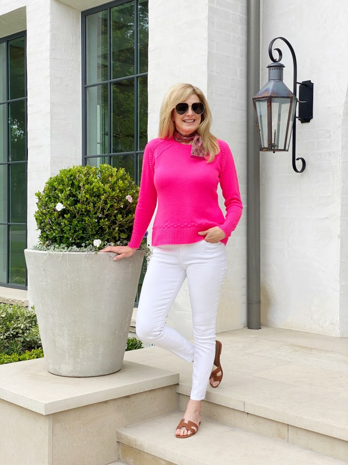 Tanya Foster in sail to sable pink sweater white jeans hermes sandals and neck scarf