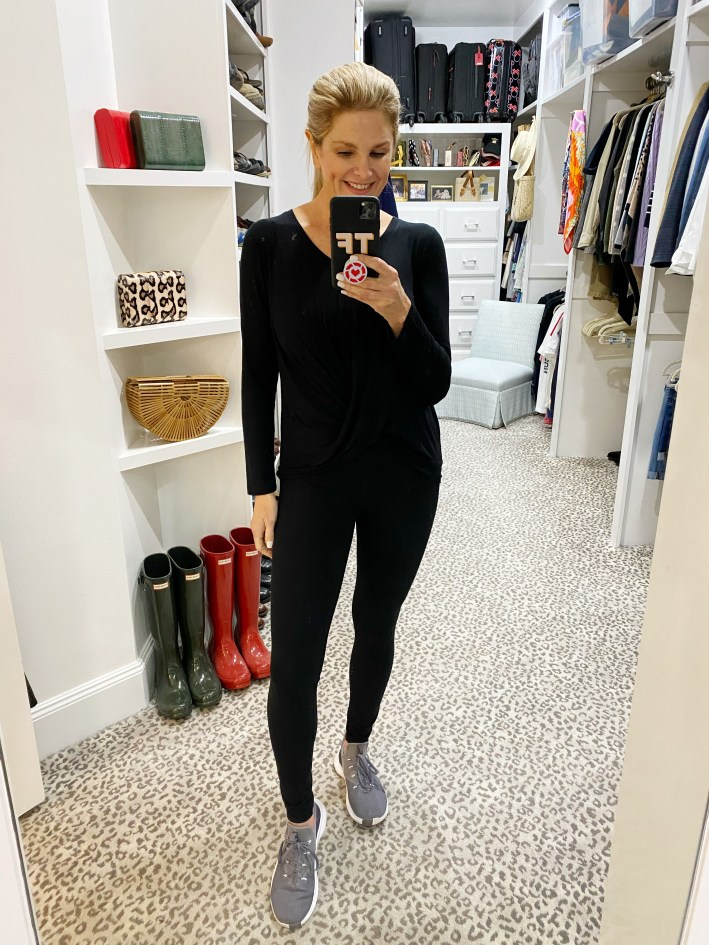 tanya foster in black leggings, black crew high low sweatshirt and tennis shoes