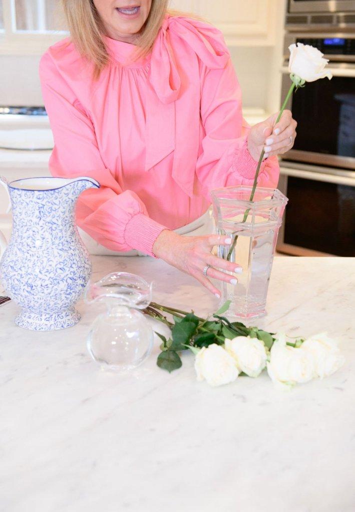Tanya foster preparing vase for the fun flower box flower arrangements