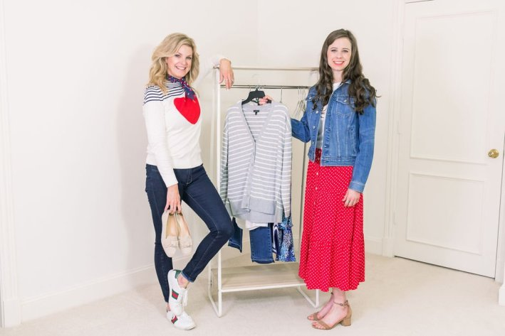 Tanya Foster and assistant in talbots clothes with a rack of clothes to prep for a photoshoot