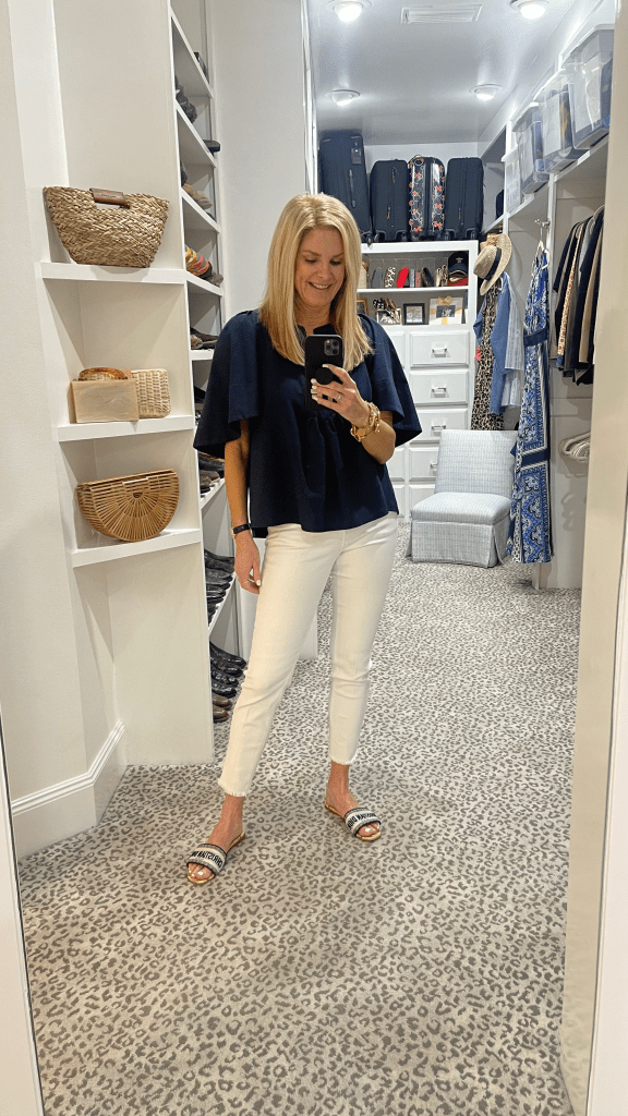 tanya foster wearing tuckernuck top with vince white skinny jeans and christian dior slide sandals