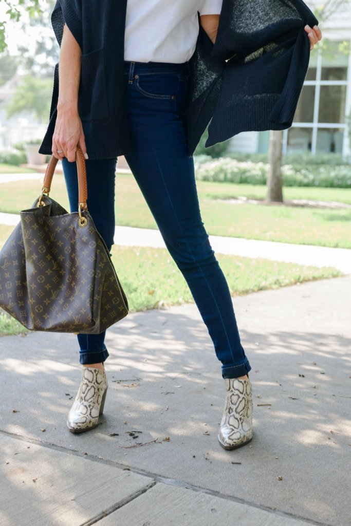 tanya foster shows how to transition your wardrobe in denim jeans louis vuitton bag and vince camuto snakeskin booties