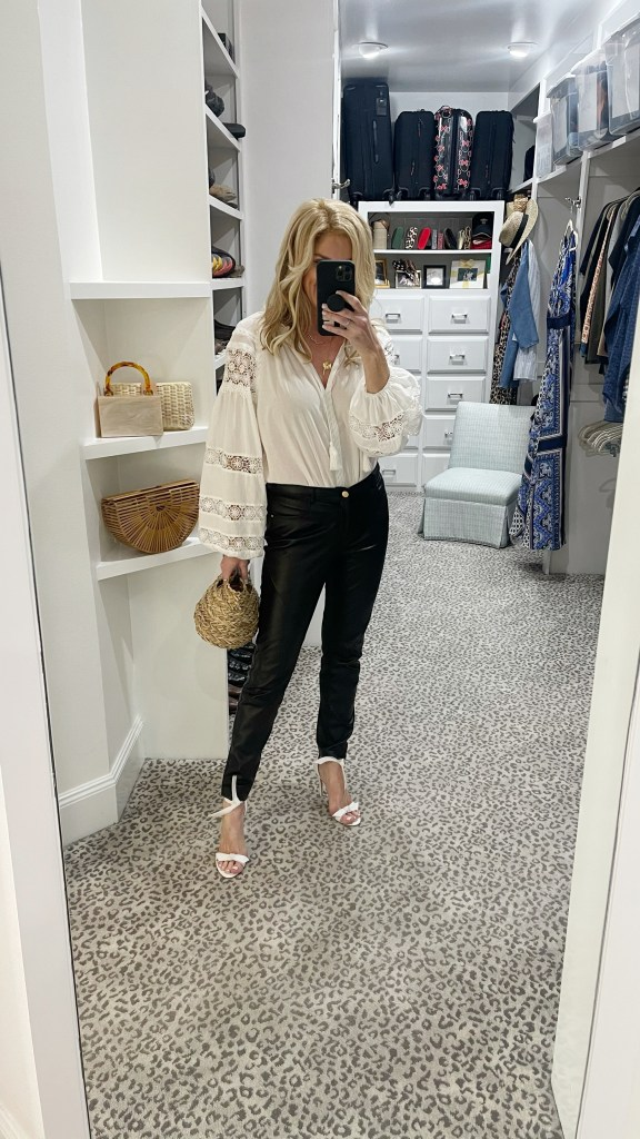 tanya foster in a white blouse leather pants and alexandre birman sandals