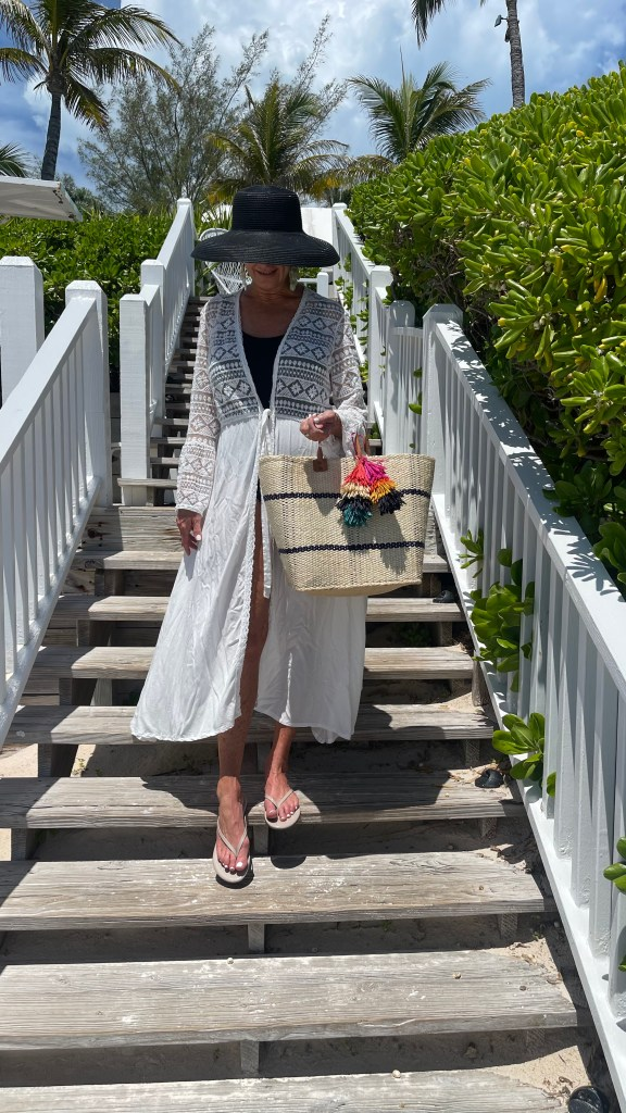 Tanya Foster wearing white lace cover up and sun hat