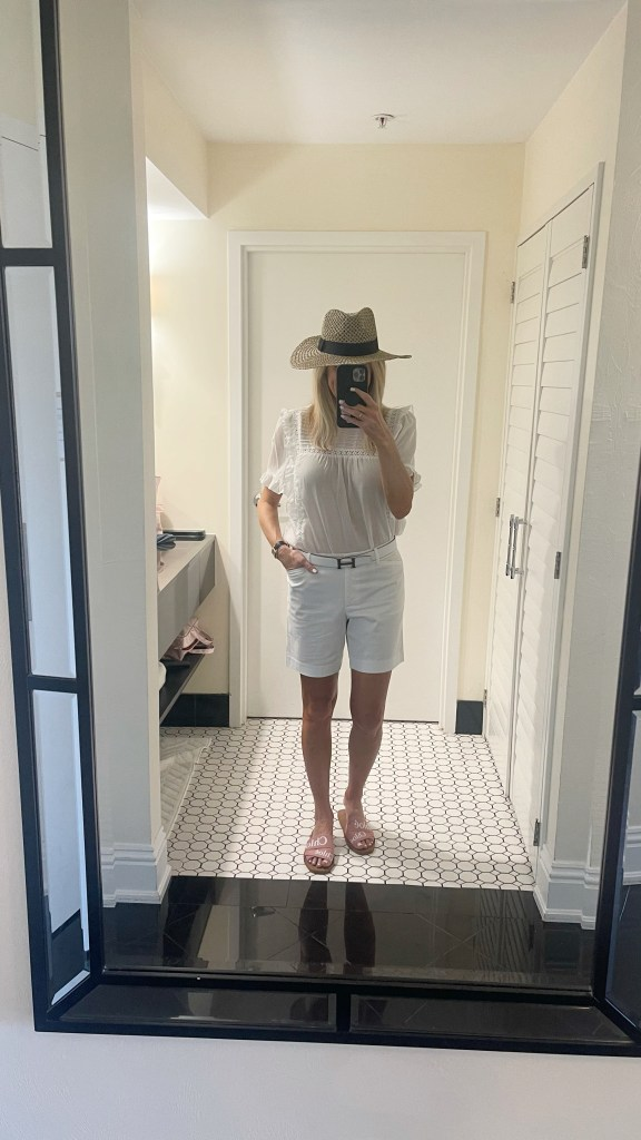 tanya foster wearing talbots girlfriend denim shorts while blouse, avara hat and chloe slide sandals
