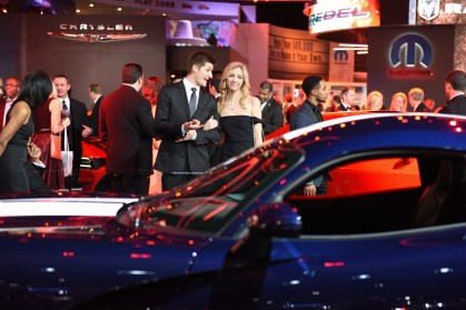 Rosalle Ryan-Campau and Jake Kalczycki, of Bloomfield Hills check out a Dodge Viper at the auto show's Charity Preview Friday evening, Jan. 15, 2016. Over 13,000Êattended the 2016 North American International Auto Show's 40th annual Charity Preview at Cobo Center in Detroit. Attendees, dressed in their very best for the black-tie event known as 'Auto Show Prom,' mingled on the showroom floor getting a look at the more than 750 vehicles before Saturday's public opening. (Tanya Moutzalias | MLive Detroit)