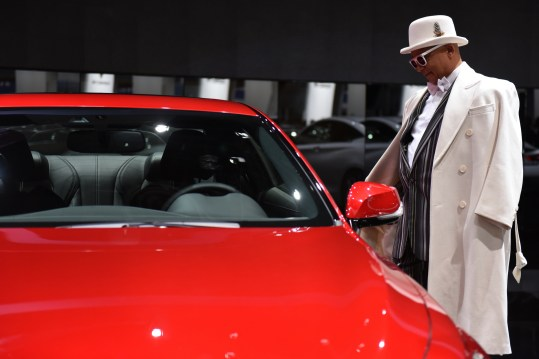 Thio Dee, of Detroit, checks out Infiniti's 2017 Q60 sports coupe at the auto show's Charity Preview Friday evening, Jan. 15, 2016. Over 13,000Êattended the 2016 North American International Auto Show's 40th annual Charity Preview at Cobo Center in Detroit. Attendees, dressed in their very best for the black-tie event known as 'Auto Show Prom,' mingled on the showroom floor getting a look at the more than 750 vehicles before Saturday's public opening. (Tanya Moutzalias | MLive Detroit)