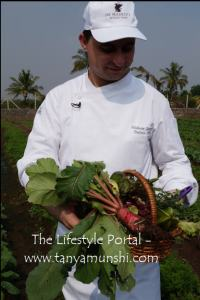 Chef Roberto with his basket full of fresh greens