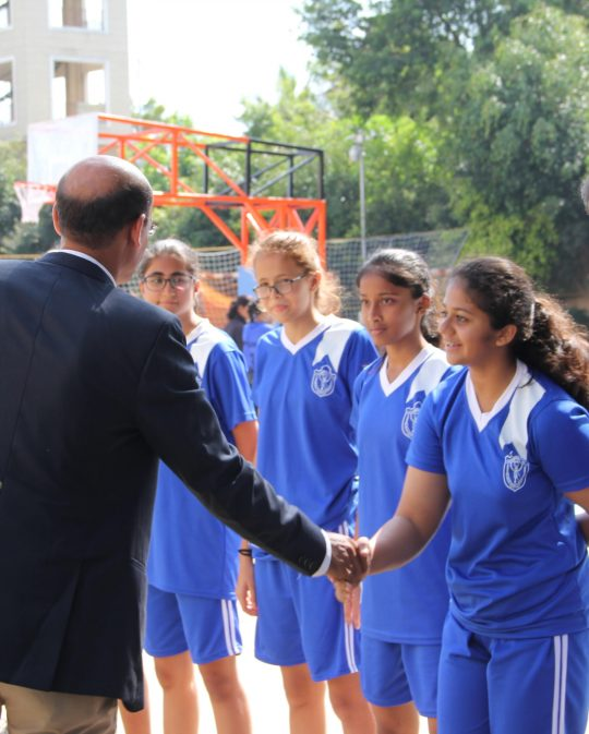 Aarya at the Inter-school Basketball meet at DPS, Undri, shaking hands with the chairman of the Pune District Basketball Association(PDBA).