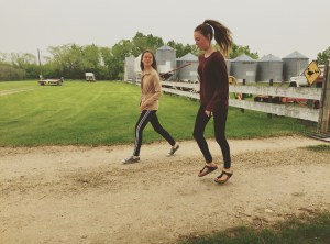 Ava and Lauren skipping on the farm