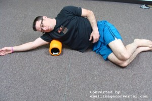 Placing the foam roller at the armpit. Lie on your side with your arm overhead. Slowly massage from the top of the arm to below the shoulder blade. Do not massage in the armpit area.