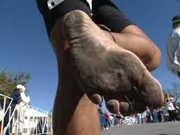 Person running barefoot. Good form running.