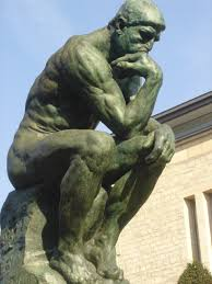 Thinking man statue. What is Neurokinetic Therapy.