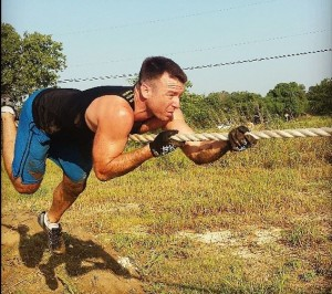 Jesse James Retherford traversing a rope - Personal Training and Coaching