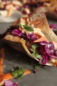 asian pork taco with slaw and chili mayo up close on tray