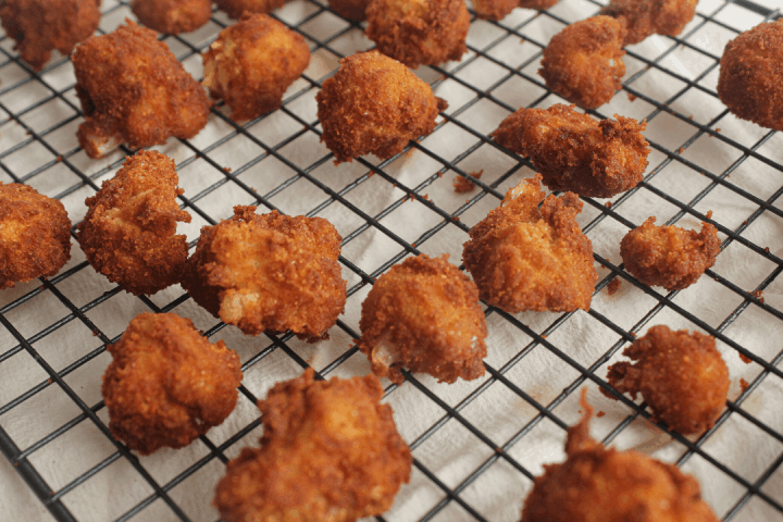 fried cauliflower on wire cooling rack