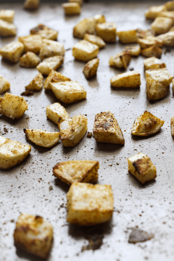 roasted cubed potatoes on sheet pan