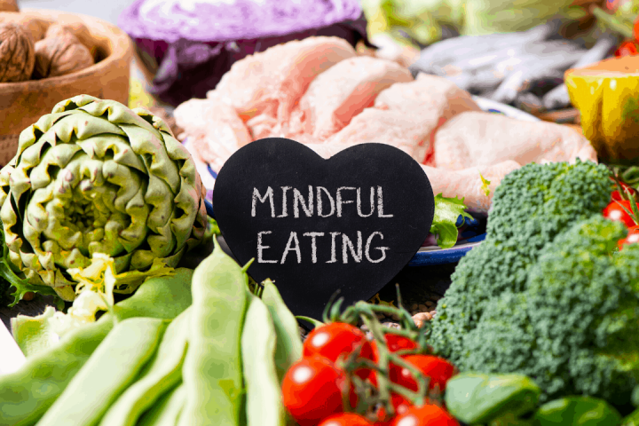 table with various foods with black heart stating mindful eating