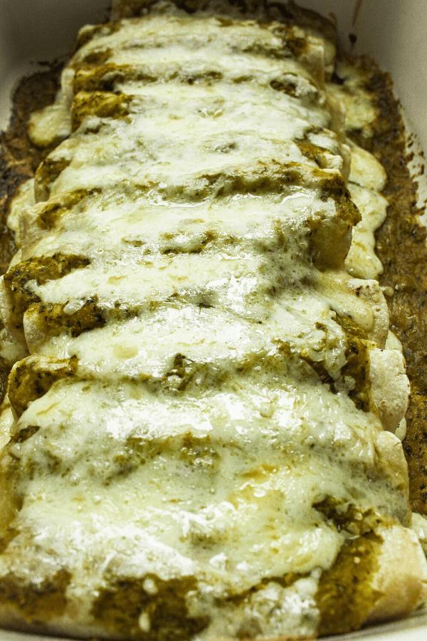 dish of baked green goddess enchiladas