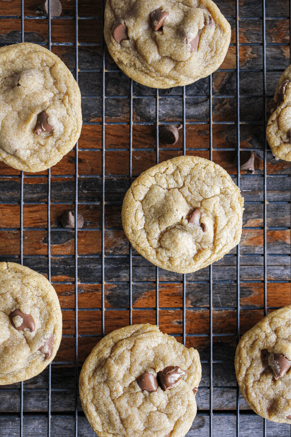 Close-up of chocolate chip cookies on wire cooling rack shot from above.